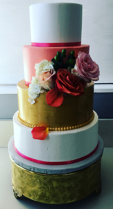 4 Tier ivory, coral and gold buttercream wedding cake decorated with fresh flowers