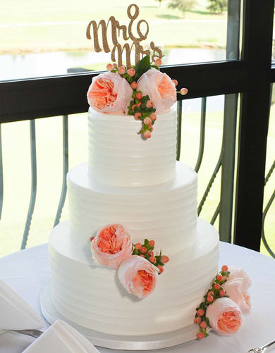 3 Tier rustic textured buttercream wedding cake decorated with fresh flowers