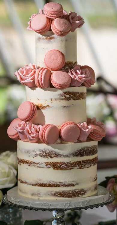 3 Tier semi naked wedding cake, decorated with French macarons and sugar flowers