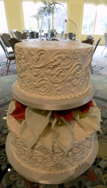 2 Tier separator pillar  buttercream wedding cake decorated with buttercream scrolls and silk calla lilies delivered at Felicita Resort Harrisburg PA