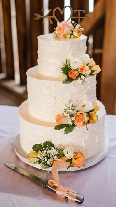 3 Tier rustic textured buttercream wedding cake, decorated with fresh flowers