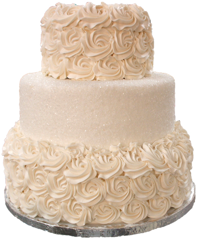 3 tier ivory buttercream wedding cake, with the top and bottom tiers covered in buttercream rosettes and and middle tier covered in sugar crystals