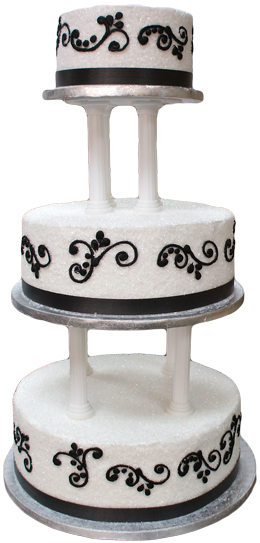 3 Tier white pillar wedding cake covered in sugar crystals and decorated in black scrolls