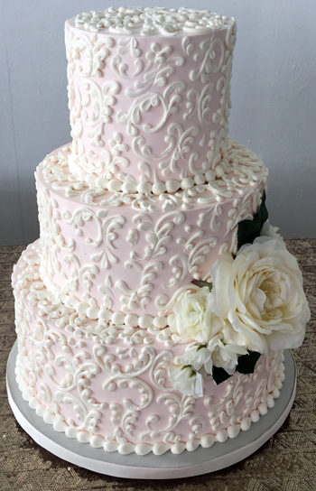3 Tier blush buttercream wedding cake, decorated with buttercream scrolls and silk flowers delivered at Lauxmont Farms Wrightsville PA