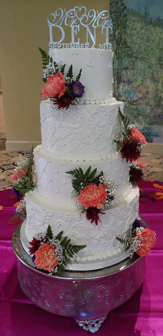 4 Tier buttercream wedding cake, decorated with Swiss dots, scrolls, quilt pattern design and fresh flowers, delivered at the Felicita Resort Harrisburg PA