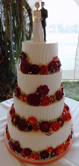 4 Tier buttercream wedding cake, decorated with an assortment of fall colored buttercream flowers delivered in Dillsburg PA