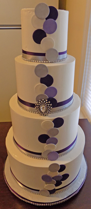 4 Tier Ercream Wedding Cake Decorated With White Silver Lilac And Purple Fondants