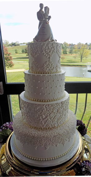 4 Tier buttercream wedding cake decorated with sugar pearls, scroll works and quilt design delivered at Heritage Hills Golf and Resort York PA