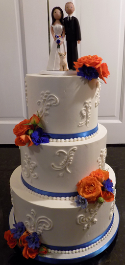 3 Tier buttercream wedding cake, decorated with blue ribbons, scattered scrolls and fresh flowers delivered at Cameron Estate Mt. Joy PA