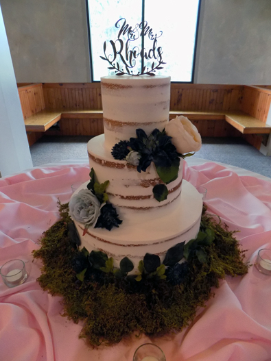 3 Tier semi naked wedding cake decorated with flowers and moss. Wedding Cakes Ski Roundtop Mountain Resort Lewisberry PA