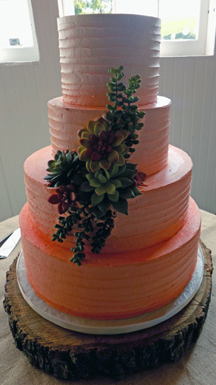 4 Tier buttercream peach ombre wedding cake decorated with succulents. Wedding Cakes Wrightsville PA