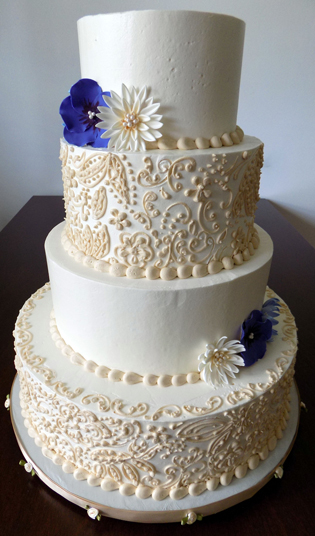 4 Tier ivory buttercream wedding cake, decorated with champagne colored buttercream lace and handmade sugar flowers. Wedding Cakes Mt Wolf PA