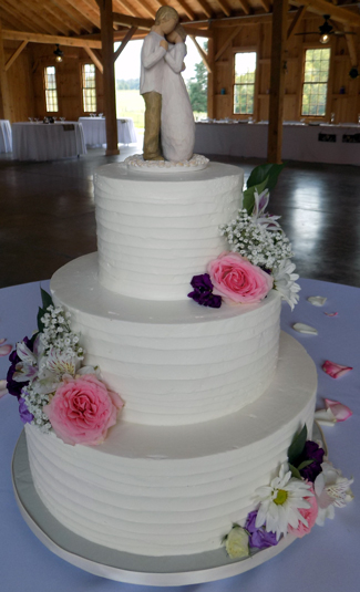 3 Tier textured rustic buttercream wedding cake, decorated with fresh flowers. Wedding Cakes White Hall MD