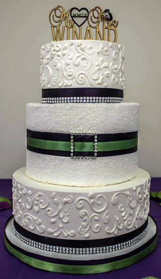 3 Tier buttercream wedding cake, decorated with buttercream scrolls, sugar crystals, purple green and bling ribbons. Wedding Cakes Gettysburg PA