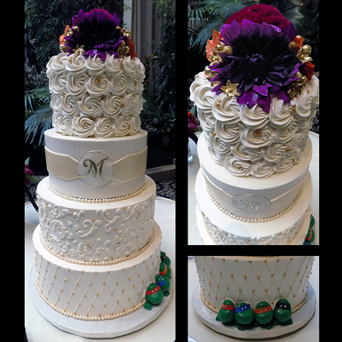 4 Tier buttercream wedding cake decorated with rosettes, scrolls, quilt deisgn, fondant sash and monogram, fondant pearls, gold sugar dragees/pearls and Ninja turtles for the groom. Wedding Cakes Lancaster PA