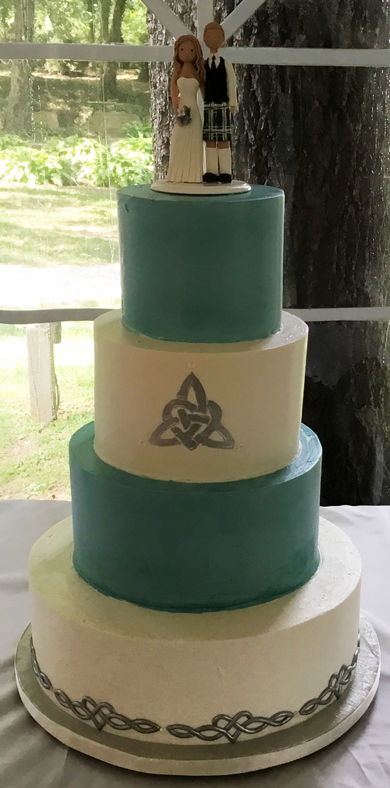 4 Tier Celtic/Irish themed wedding cake, iced  with teal & ivory buttercream & decoroated with silver Celtic love knots delivered at Historic Shady Lane Manchester PA. Wedding Cakes Manchester PA PA
