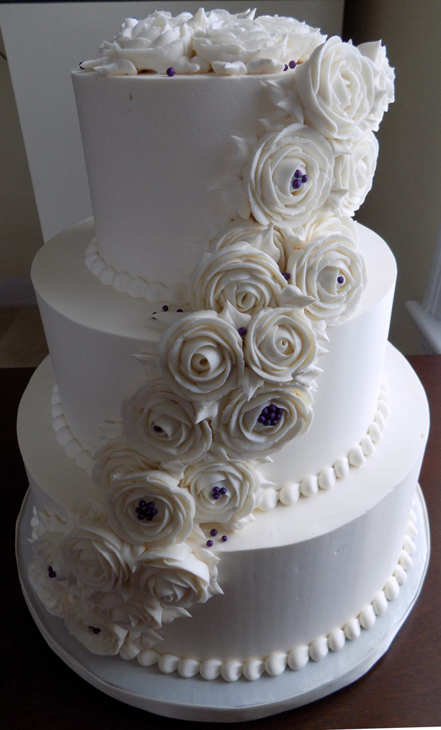 3 Tier buttercream wedding cake, decorated with cascading ivory buttercream roses and deep purple sugar pearls delivered at Harvest View Barn Elizabethtown PA