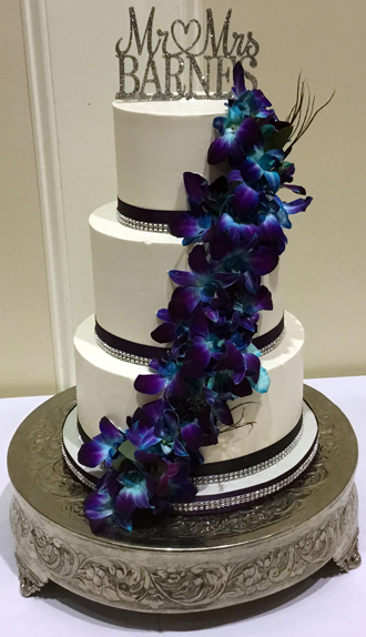 3 Tier buttercream wedding cake, decorated with plum and diamond bling ribbons and fresh cascading orchids delivered at The Gettysburg Hotel PA