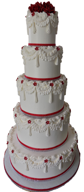 Five tier buttercream wedding cake decorated with buttercream swags, red and diamond bling ribbons and handmade red and white sugar roses and flowers - wedding cakes Wrightsville PA
