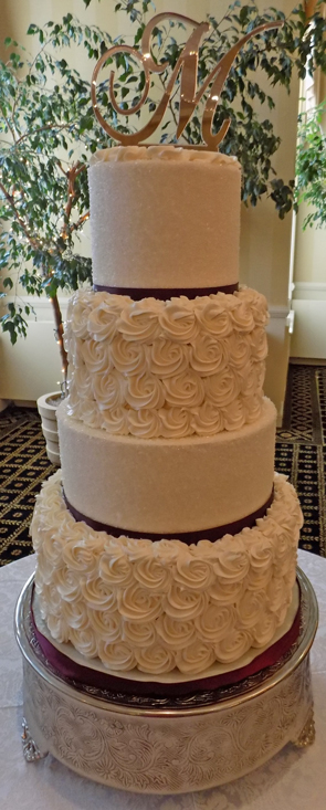 Four tier buttercream wedding cake decorated with buttercream rosettes and sugar crystals delivered at the Out Door Country Club in York PA