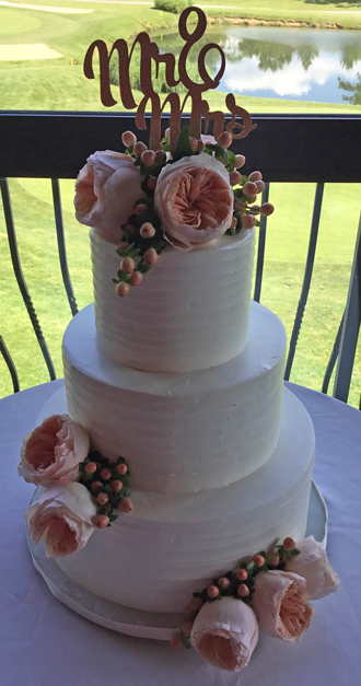 3 Tier rustic textured buttercream wedding cake, decorated with fresh peach tea roses and berries delivered at Heritage Hills Gold Resort in York PA