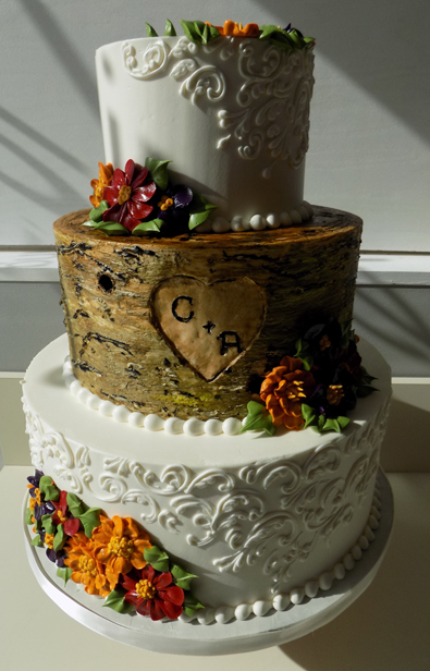 3 Tier wood/tree trunk and lace buttercream wedding cake, decorated with fall colored buttercream flowers. Wedding Cakes at The Willis House York PA