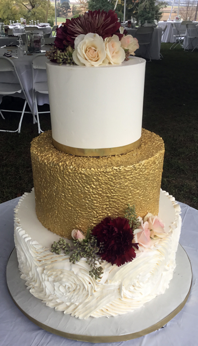 3 Tier buttercream wedding cake, decorated with edible gold sequins and buttercream rosette ruffles