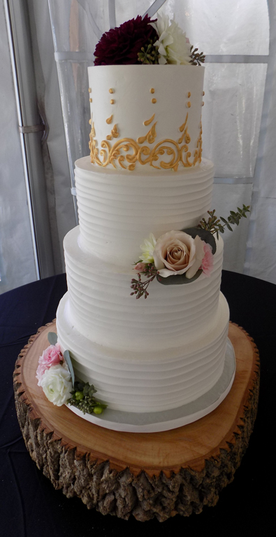 3 Tier Gold scrolls and rustic buttercream wedding cake. Wedding Cakes at Historic Shady Lane Manchester PA