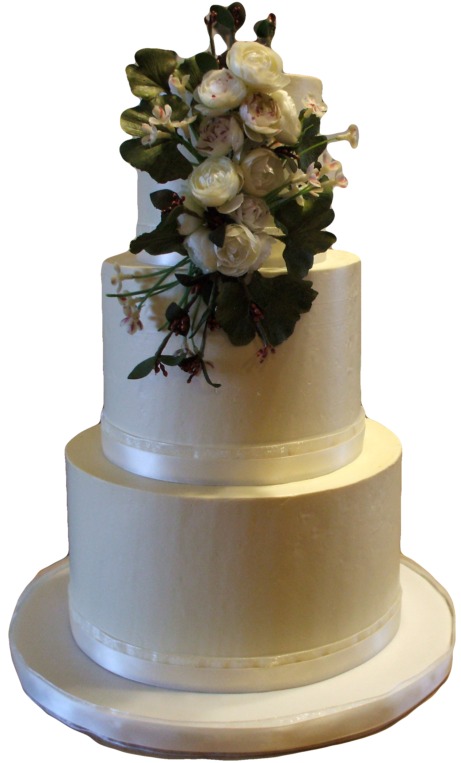 3 tier buttercream wedding cake  decorated with silk flowers