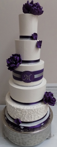 5 Tier buttercream wedding cake, decorated with purple, silver and diamond ribbons, buttercream scrolls and handmade purple sugar peonies - wedding cakes Harrisburg PA