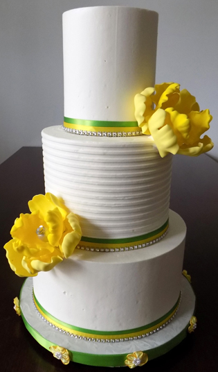 3 Tier buttercream wedding cake, decorated with lime green, yellow and blings diamond ribbons as well as yellow handmade sugar peonies with diamond centers - wedding cakes Baltimore MD
