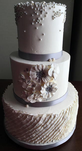 3 Tier buttercream wedding cake decorated with buttercream pleats, silver and pearl sugar pearls/dragees and buttercream flowers with silver high lights - bridal shower cakes York Lancaster PA<br /> <em>Wedding Cakes Lancaster PA</em>