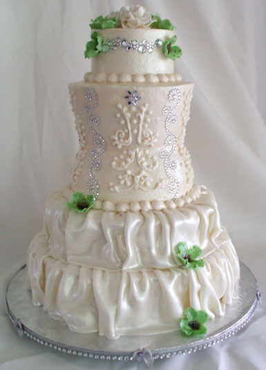 A buttercream and fondant wedding cake carved to resemble bride in a wedding dress