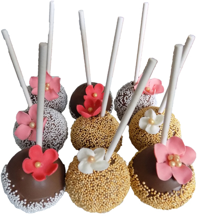 Yellow cake pops, dipped in milk chocolate and decorated with pearl and gold non-perils and decorated with sugar flowers. Cake pops York PA