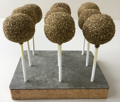 Cake pops dipped in milk chocolate with gold sugar crystals. Cake pops York PA