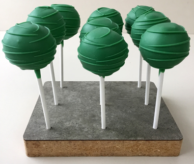 Cake pops dipped in green chocolate with green chocolate stripes. Cake pops York PA