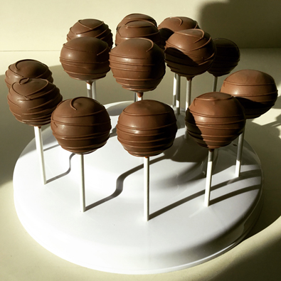 Cake pops dipped in milk chocolate with milk chocolate stripes. Cake pops York PA