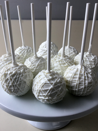 Cake pops dipped in white chocolate with cage chocolate stripes. Cake pops Lancaster PA