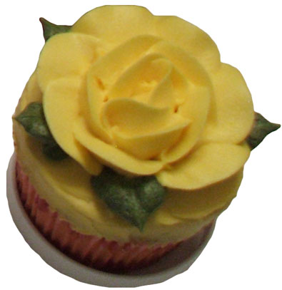 cup cake with yellow open rose