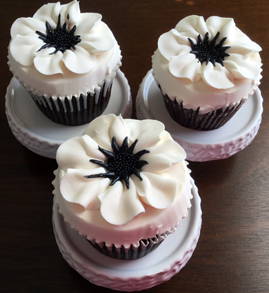 Chocolate cupcakes, filled with peanut buttercream, iced with vanilla buttercream and decorated with buttercream anemones delivered at the Wyndridge Farm Dallastown PA
