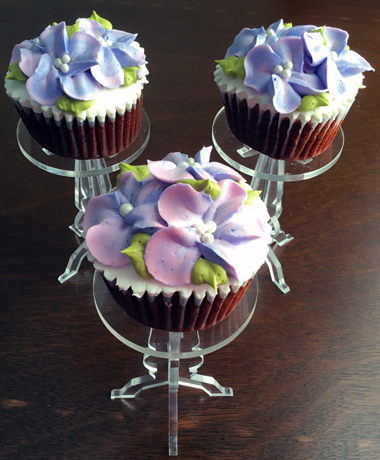 Red velvet cupcakes filled with cream cheese icing, iced with vanilla buttercream and decorated with buttercream hydrangeas