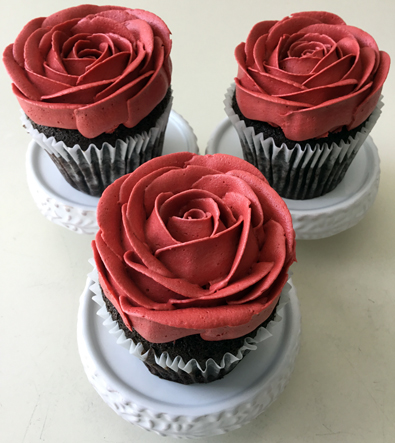 Cupcakes decorated with red buttercream roses