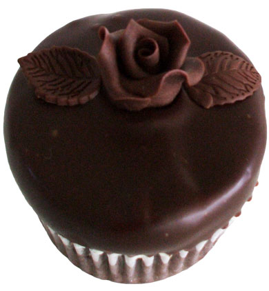 Chocolate cupcake, filled and iced with vanilla buttercream, dipped in ganache and decorated with chocolate flowers