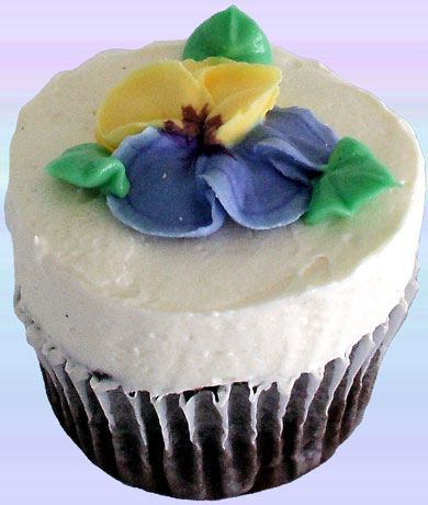 Chocolate cupcakes topped with a royal icing yellow and purple pansy