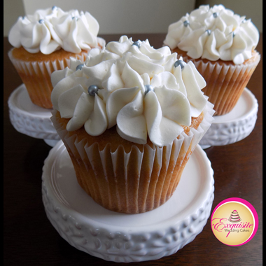 Brown sugar caramel cupcakes, filled with cream cheese icing and decorated with vanilla buttercream hydrangeas and silver sugar pearls