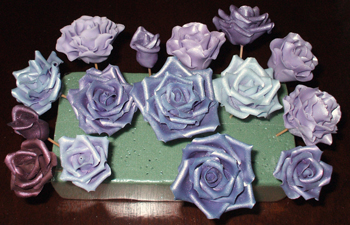 Assortment of different shades of sugar purple roses