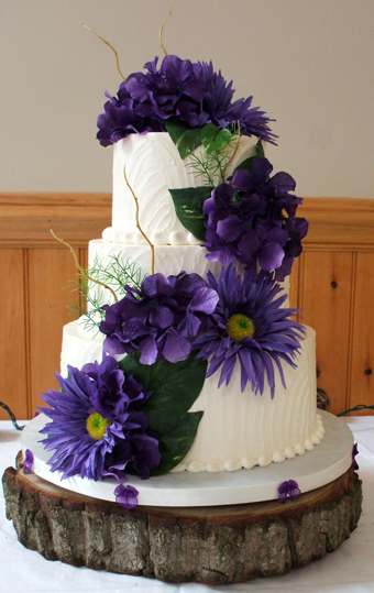 3 Tier textured buttercream wedding cake, decorated with purple silk hydrangeas and sunflowers - Wedding Cakes Felton PA
