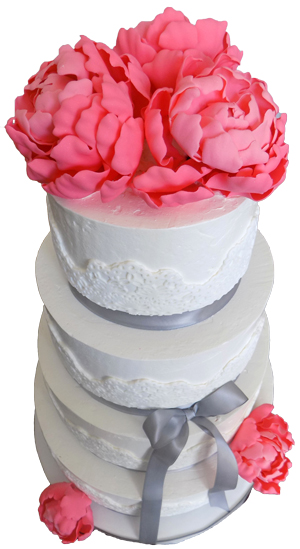 picture of 4 tier buttercream wedding cake, decorated with fondant lace, silver ribbons and handmade coral gumpaste peonies  delivered to the General Sutter Inn in Lititz PA. Wedding cakes Lititz PA