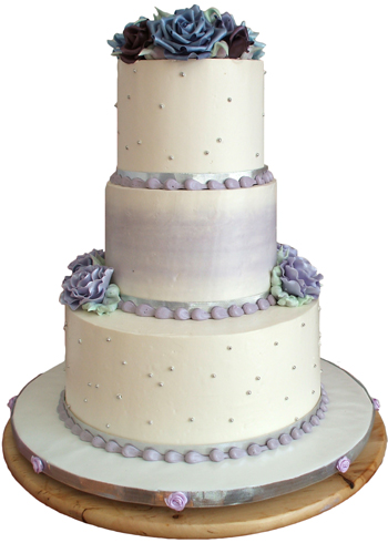 picture of 3 tier white and purple buttercream wedding cake delivered in York PA. Wedding cakes York PA